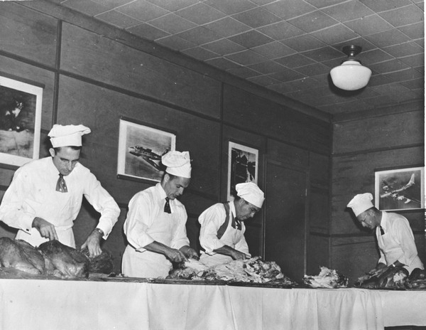 2014-1127-Men carving turkeys for Thanksgiving dinner at U.S.O. club in Pensacola-November 1944